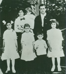 """Marie, holding Clarence, and Louis Duplantis. The children in front are Edna, Ella, Arthur (""""Pee Wee"""") and Wilda."""