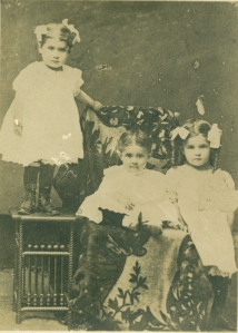Wilda, standing, with Ella and Edna (l to r)